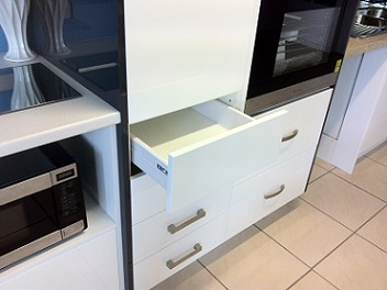 Kitchen showroom push to open drawer.