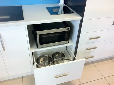 Image of under-bench microwave with drawer.