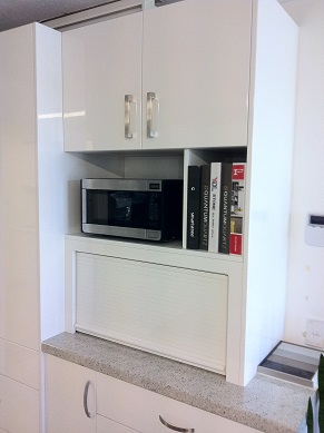 Microwave appliance cupboard combination.